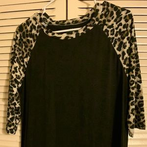 Leopard and black top